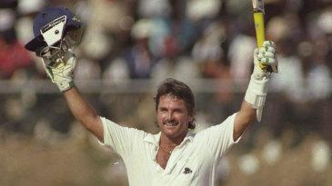 Allan Lamb celebrates his century