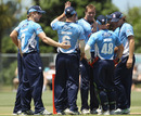 Michael Bates is congratulated by his team-mates after dismissing Shahid Afridi, Auckland v Pakistanis, Twenty20, Auckland, December 23, 2010