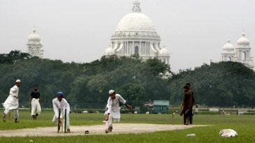 Students of a madrassa play cricket on Kolkata's Maidan