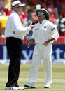 Sachin Tendulkar shares a light moment with umpire Steve Davis
