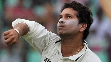 Sachin Tendulkar prepares to bowl