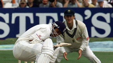 Mark Butcher ducks a short ball as Brian McMillan looks on from the slips