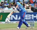 Rohit Sharma hits one to the leg side during his 53 off 34 balls