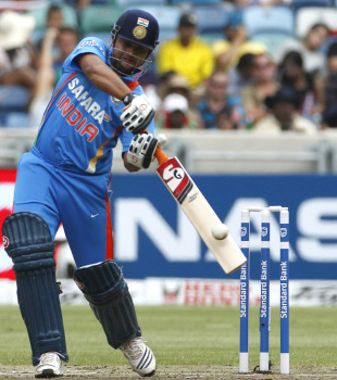 Suresh Raina attempts a big shot during his 41 off 23 balls, South Africa v India, only Twenty20, Durban