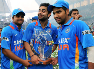 Suresh Raina, Virat Kohli and Rohit Sharma pose with the trophy after winning the one-off Twenty20 international, South Africa v India, only Twenty20, Durban