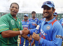 Makhaya Ntini and MS Dhoni shake hands after Ntini's last match, South Africa v India, only Twenty20, Durban