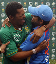 Former Chennai Super Kings team-mates Makhaya Ntini and Suresh Raina embrace, South Africa v India, only Twenty20, Durban