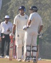 Aakash Chopra and Vineet Saxena chat during their half-century opening stand