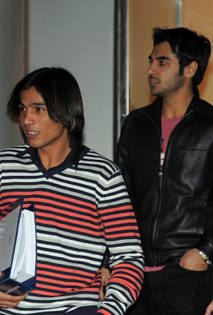Mohammad Amir and Salman Butt leave after attending the hearing, Doha, 11 January, 2011