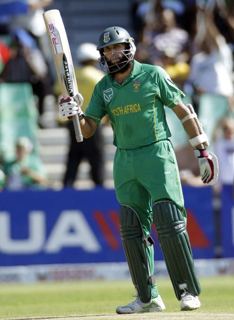 Hashim Amla acknowledges the crowd after reaching his half-century