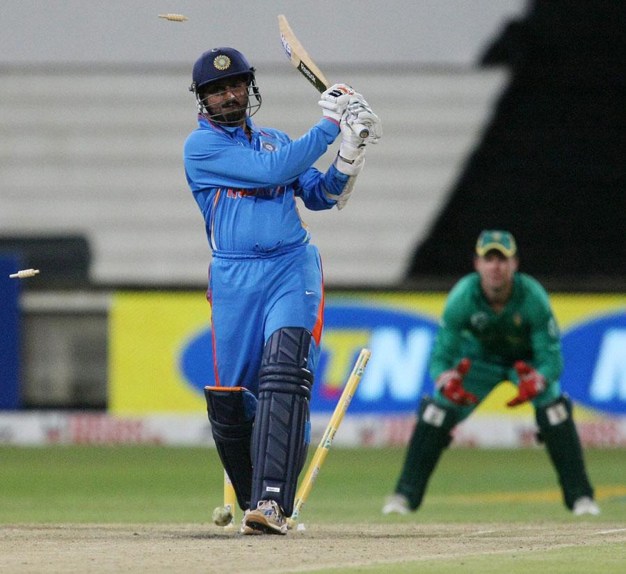 Harbhajan Singh is clean bowled by Wayne Parnell