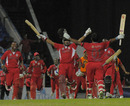 Trinidad & Tobago celebrate their last-ball victory over Canada
