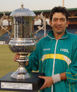 Hasan Raza, the HBL captain, poses with the winner's trophy, HBL v PIA, Quaid-e-Azam Trophy Division One Final, fifth day, Karachi, January 17, 2011