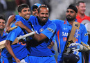 Yusuf Pathan celebrates the victory with Ashish Nehra and Harbhajan Singh, South Africa v India, 3rd ODI, Cape Town, January 18, 2011