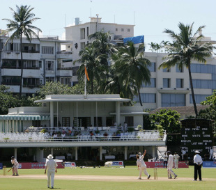 The Brabourne Stadium's pavilion had chairs set up right up to the boundary's edge