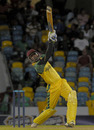 Marlon Samuels plays a big shot during his 53