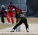 Papua New Guinea wicketkeeper Jack Vare completes a run out, Oman v Papua New Guinea, WCL Division Three, Mong Kok, January 22, 2011