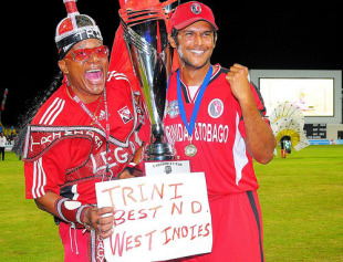 Daren Ganga poses with the Caribbean T20 trophy alongside a Trinidad fan
