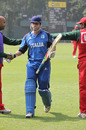 Italy captain Alessandro Bonora is congratulated by the Oman players as he leaves the field after scoring 124 not out in the Pepsi ICC WCL Division 3 match played at Kowloon Cricket Club, Hong Kong, on 25th January 2011