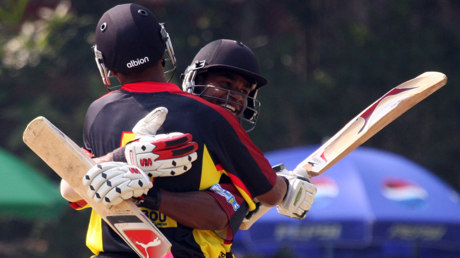 Tony Ura and Chris Amini embrace after securing Papua New Guinea's nine-wicket win