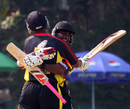 Tony Ura and Chris Amini embrace after securing Papua New Guinea's nine-wicket win, Denmark v Papua New Guinea, WCL Division Three, Kowloon, January 26, 2011