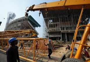 A payloader removes an iron structure  during the renovation of Eden Gardens, Kolkata, January 5, 2011