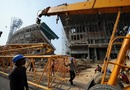 A payloader removes an iron structure  during the renovation of Eden Gardens