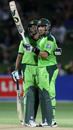 Misbah-ul-Haq is congratulated by Younis Khan on reaching his half-century, New Zealand v Pakistan, 4th ODI, Napier, February 1, 2011