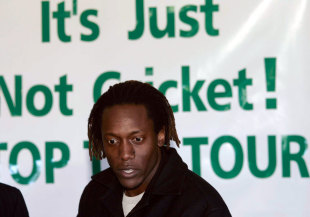 Henry Olonga speaks against New Zealand's tour of Zimbabwe at a press conference , Christchurch, July 12, 2005