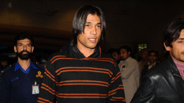 Mohammad Amir, Salman Butt and Mohammad Asif look on