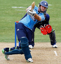 Tim McIntosh lifts one down the ground during his 161, Auckland v Otago, 3rd Preliminary Final, NZC one-day competition, Auckland, February 9, 2011