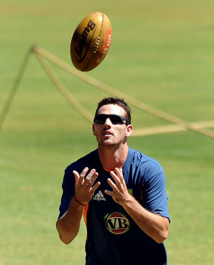 Shaun Tait catches a rugby ball at Australia's training session, Bangalore, February 11, 2011