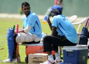 Chamara Kapugedera and Ajantha Mendis take a break during practice at the SSC, Colombo, February 11, 2011