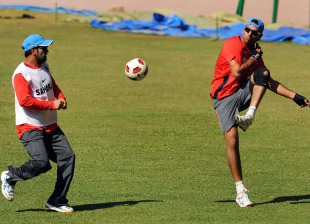 MS Dhoni and Yuvraj Singh during their football routine, Bangalore, February 11, 2011