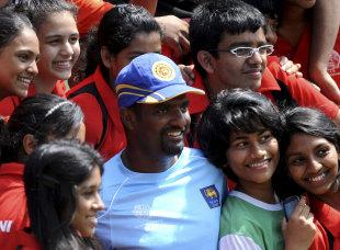 Muttiah Muralitharan with some young fans during training at the SSC, Colombo, February 11, 2011