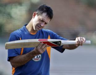 Ricky Ponting checks his bat during training, Bangalore, February 12, 2011