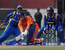 Tom de Grooth attempts a sweep shot during his 76, Sri Lanka v Netherlands World Cup warm-up match, Colombo, February 12, 2011