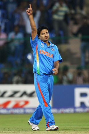 Piyush Chawla celebrates the wicket of Michael Clarke, India v Australia, World Cup warm-up match, Bangalore, February 13, 2011