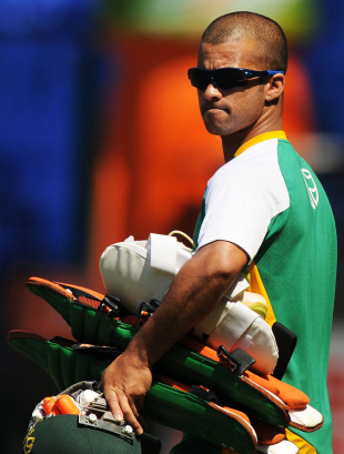 JP Duminy heads for the nets, Bangalore, February 14, 2011