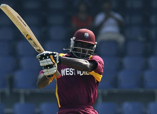 Chris Gayle lashes a boundary during his frenetic innings, Sri Lanka v West Indies, World Cup warm-up match, Colombo, February 15, 2011