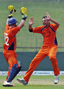 Atse Buurman and Bernard Loots celebrate the wicket of David Obuya, Kenya v Netherlands World Cup warm-up match, Sinhalese Sports Club, Colombo, February 15, 2011