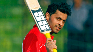 Rizwan Cheema raises his bat after his blazing innings against England