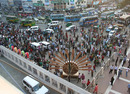 People crowd the area outside the Bangabandhu National Stadium the day before the opening ceremony, Dhaka, February 16, 2011