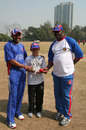 Steve Massiah and Clayton Lambert present a signed ball to young Ryan Schimpf, Hong Kong, January 23, 2011