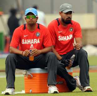 Suresh Raina and Yusuf Pathan take a breather during practice, Shere Bangla Stadium, Mirpur, February 18, 2011