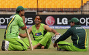 Abdul Razzaq, Shoaib Akhtar and bowling coach Akib Javed have a chat during practice, Hambantota, February 21, 2011