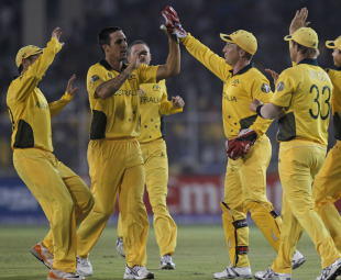 Mitchell Johnson is congratulated on dismissing Tatenda Taibu, Australia v Zimbabwe, Group A, World Cup 2011, Ahmedabad, February 21, 2011