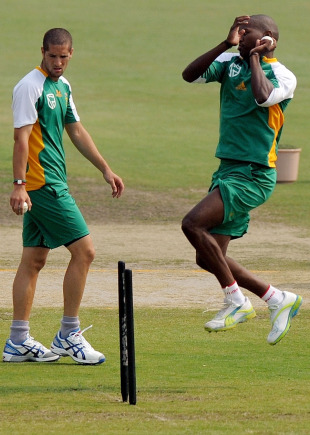 Lonwabo Tsotsobe is watched by Wayne Parnell as he bowls during a training session, New Delhi, February 23, 2011