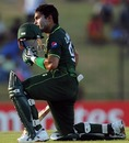 Umar Akmal kisses his helmet on reaching his half-century