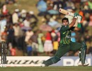 Umar Akmal cracks the ball square on the off side
